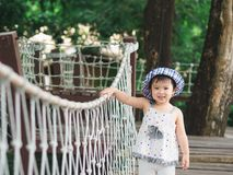 Happy little girl smiling face on bokeh background with vintage stock photo