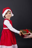 Happy little girl smiling with gift Royalty Free Stock Photography