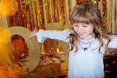 Happy Little girl smiling. Gold joy scene Royalty Free Stock Photo