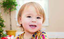 Happy little girl smiling in her house Stock Photo