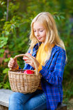 Happy little girl smiling holding apples in the Stock Image