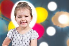 Happy little girl smiling in portrait in children kid play area royalty free stock photo