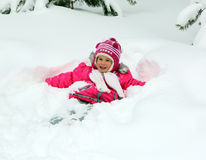 Happy little girl in snow Stock Image