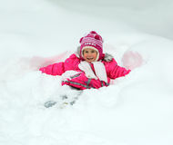 Happy little girl in snow stock photo