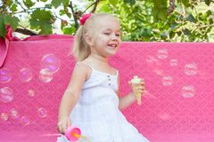 Happy little girl with soap bubbles Royalty Free Stock Image