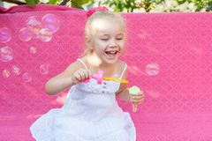 Happy little girl with soap bubbles Royalty Free Stock Photography
