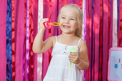 Happy little girl with soap bubbles Stock Image