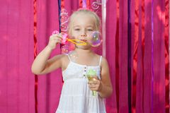 Happy little girl with soap bubbles Stock Photo