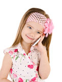Happy little girl speaking by cell phone isolated. On white Stock Photo