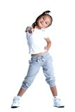 Happy little girl in sportswear thumbs up isolated Stock Photos