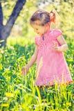 Happy little girl in spring garden Royalty Free Stock Photo