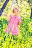 Happy little girl in spring garden Royalty Free Stock Image