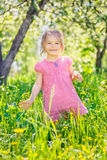 Happy little girl in spring garden Stock Photography