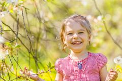 Happy little girl in spring sunny park Royalty Free Stock Image