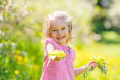 Happy little girl in spring sunny park Stock Photo