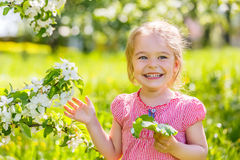 Happy little girl in spring sunny park Royalty Free Stock Photo