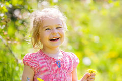 Happy little girl in spring sunny park Royalty Free Stock Photography