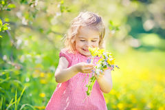 Happy little girl in spring sunny park Stock Images