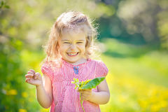 Happy little girl in spring sunny park Royalty Free Stock Images