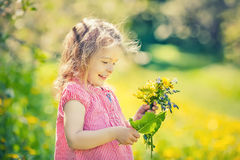 Happy little girl in spring sunny park Royalty Free Stock Photos