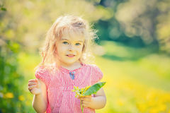 Happy little girl in spring sunny park Stock Image