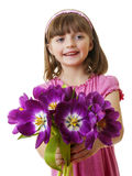 Happy little girl with spring tulips Royalty Free Stock Photos