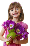 Happy little girl with spring violet tulips Stock Photo