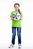 Happy little girl standing with ball. Stock Photo