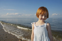 Happy Little Girl Standing At Beach Royalty Free Stock Photos