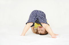 Free Happy Little Girl Standing On Head Upside Down Stock Images - 84180984