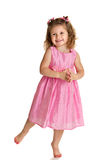 Happy Little Girl Standing on White Background Stock Image