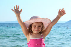 Happy little girl with straw hat Stock Photography