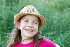 Happy little girl with straw hat Royalty Free Stock Photo