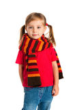 Happy little girl in a striped scarf Royalty Free Stock Photo