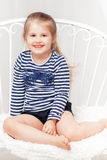 Happy little girl in striped shirt. On white background stock images