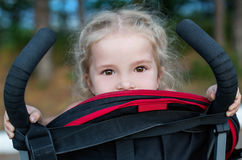 Happy little girl in a stroller Stock Images