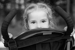 Happy little girl in a stroller Royalty Free Stock Photography