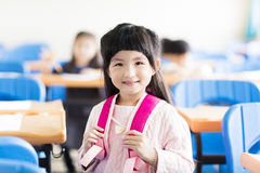Happy little girl student  in the classroom Royalty Free Stock Photos