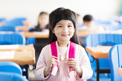 Happy little girl student  in the classroom Royalty Free Stock Photo