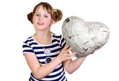 Happy little girl in studio with newspaper heart Stock Image