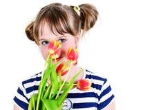 Happy little girl in studio Stock Images