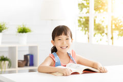 Happy little girl study in the living room Stock Photography