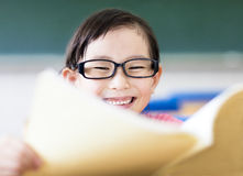 Happy little girl studying in the classroom Stock Photography