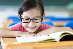 Happy little girl studying in the classroom Royalty Free Stock Images
