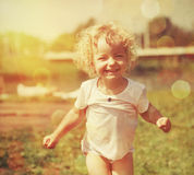 Happy little girl in summer sunlight Stock Photo