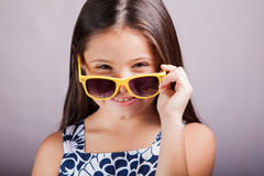 Happy little girl with sunglasses Royalty Free Stock Photo