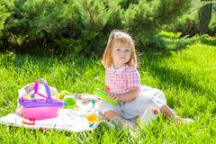 Happy little girl in the Sunny meadow Stock Photo