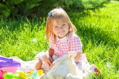 Happy little girl in the Sunny meadow Royalty Free Stock Photo
