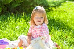Happy little girl in the Sunny meadow Royalty Free Stock Photos