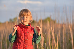 Happy little girl on  sunset Royalty Free Stock Photos